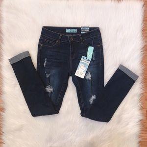 Dark wash distressed cuffed ankle skinny jeans